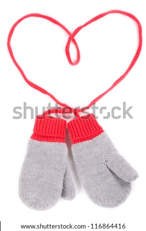 pair of gray baby mittens on a string in the form of heart. Isolate on white background.