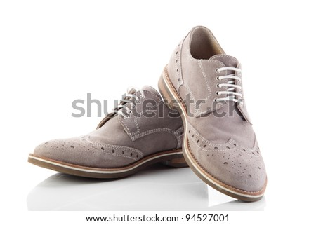 pair of grey men's shoes on white background