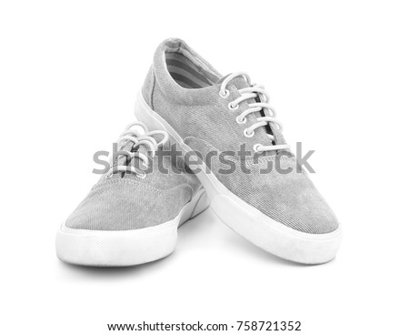 Pair of grey tennis shoes, isolated on white #758721352