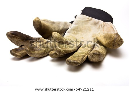 Pair of grubby gardening gloves from low perspective isolated against white background.