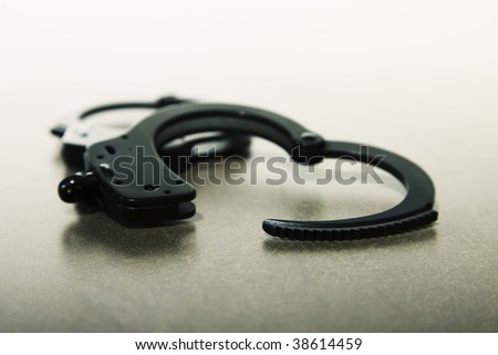 Pair of handcuffs open on a tabletop