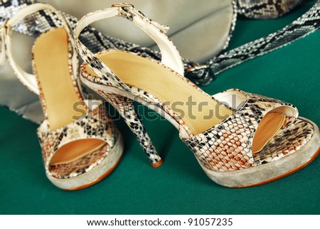 pair of high heeled shoes over green