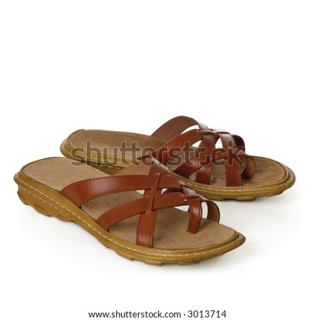 pair of leather sandals isolated on white background