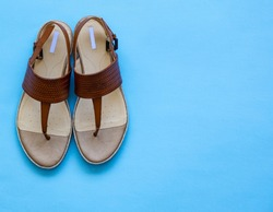 Pair of Leather Sandals on Bright Blue Background. Shoes, Sandals.