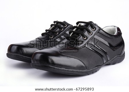 Pair of leather sport shoe isolated on white background - stock photo