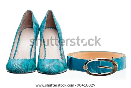 Pair of leather women shoes and belt isolated over white