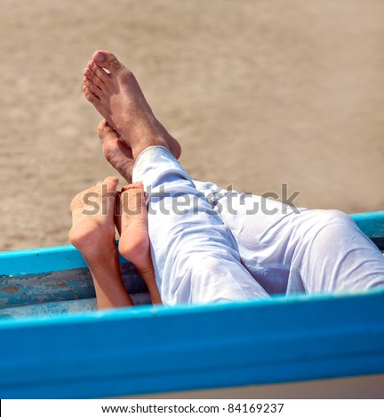 pair of legs in the boat on the beach