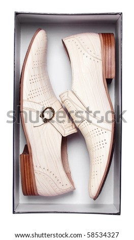 Pair of male shoes in box isolated on white. With path