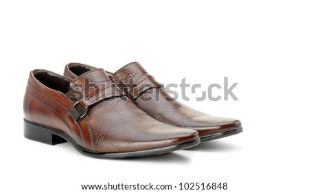 Pair of man's shoes. A red skin. It is isolated on a white background