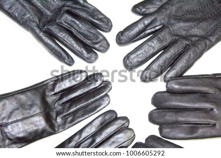 Pair of men's black leather gloves isolated on white background. black new leather gloves on white. fashion leather gloves