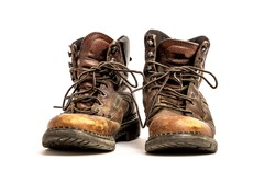Pair of Men's Dirty Grungy Beat Up Brown Leather Work Boots with Long Laces Isolated on White Background