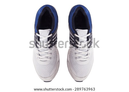 Pair of men\'s white sneakers on a white background, top view