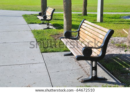 Pair of metal and wooden benches at a beach park in St. Petersburg, Florida