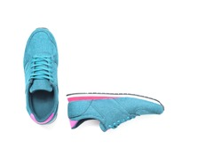 pair of new blue sneakers isolated on white background.