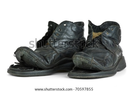Pair of old boots  isolated on the white background - stock photo