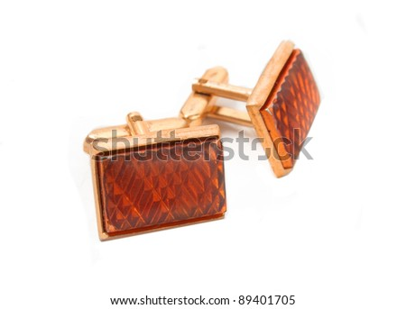 Pair of old retro cuff links in closeup on a white background
