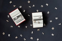 Pair of open books and letters of the English alphabet on a dark background. Education, school, study, reading concept.