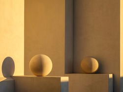 Pair of ornamental spheres, illuminated by light from setting sun, each on a ledge by exterior concrete wall of house in Alys Beach, Florida, USA
