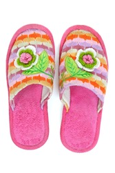 pair of pink female house slippers with knitted decorative flowers, isolated