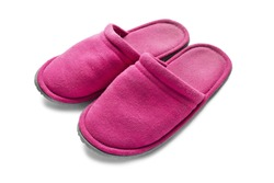 Pair of pink slippers on white background closeup