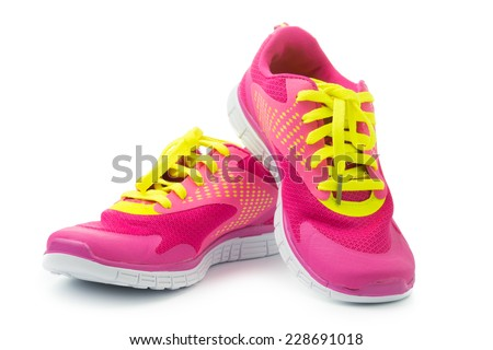 Pair of pink sport shoes on white background ストックフォト ©