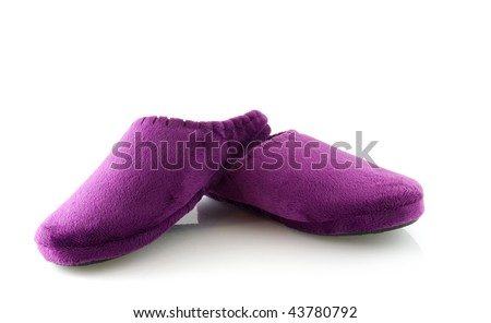 Pair of purple slippers isolated on white background