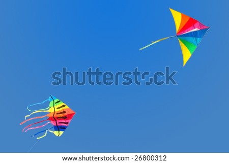 Pair of rainbow kites flying