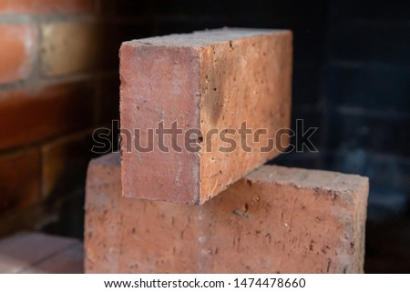 pair of red bricks close up, building material for building a house and a fireplace #1474478660