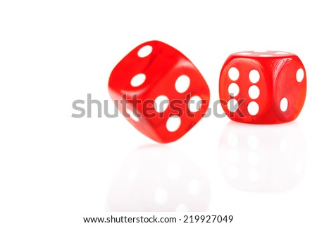 Pair of red dice isolated on white background with reflection #219927049