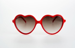 Pair of Red Heart Shaped Sunglasses on White Background