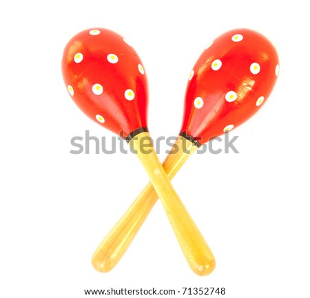 Pair of red maracas made of wood on white isolated.