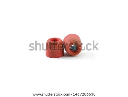 pair of red sponge earphone pads of in-ear earphones isolated on white background.