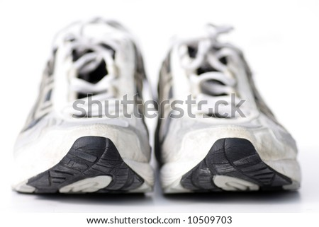 pair of running-shoes on white, very shallow depth of field - stock photo