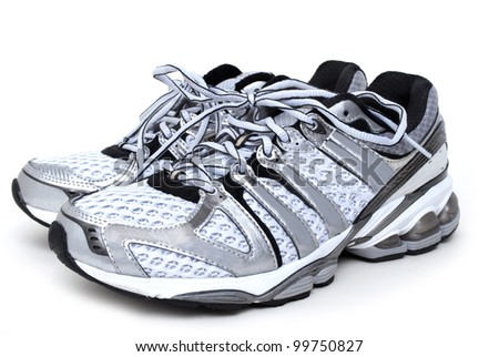 pair of running shoes white background