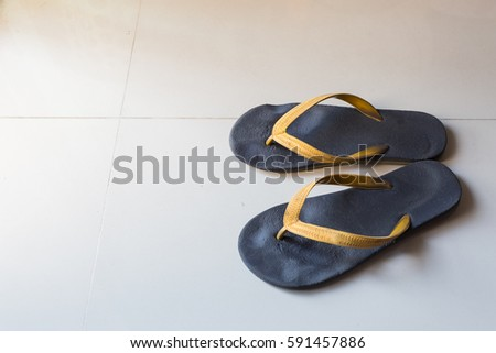 c72ef00fd92 ... slipper product with black and yellow stripes isolated on white · White  flip flops isolated on yellow background.  1346228480 · Pair of sandal on  tile.