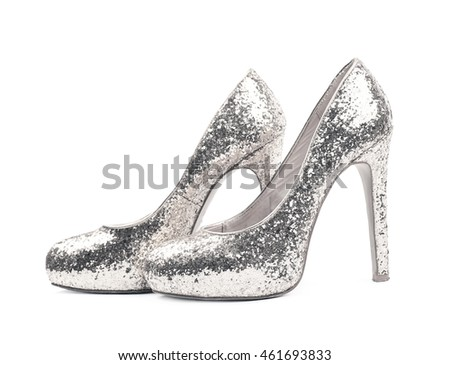 56d276ae3a Pair of shining silver high-heeled footwear shoes, composition isolated  over the white background