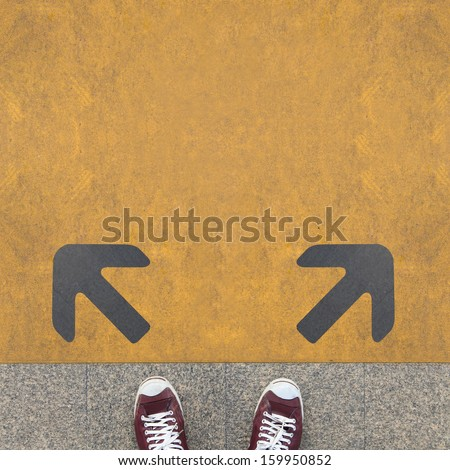 pair of shoes standing on a...