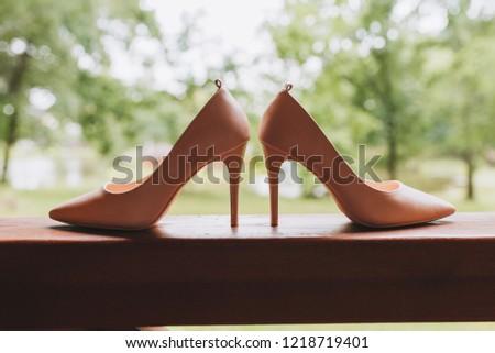 Pair of simple elegant high heeled shoes #1218719401
