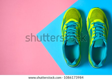 Pair of sport shoes on colorful background. New sneakers on pink and blue pastel background, copy space. Overhead shot of running shoes. Top view, flat lay ストックフォト ©
