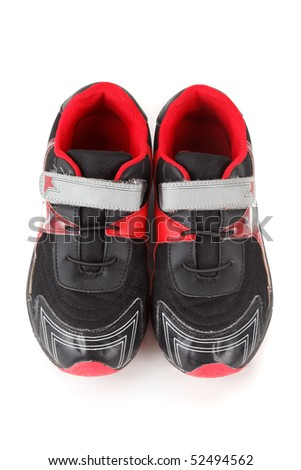 Pair of sports shoes, black and red colors on white background. Isolated. View from above.