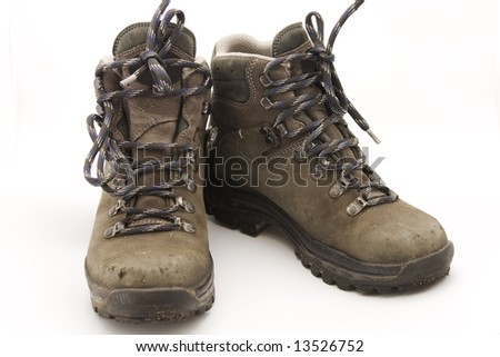 Pair of sturdy used hiking boots on white background
