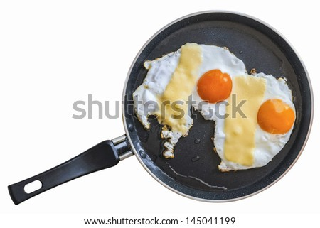 Pair of sunny side up eggs in a  frying pan, isolated on white, equipped with clipping path.