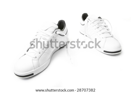Pair of tennis sneakers over the white background