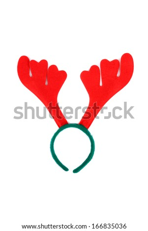 Pair of toy reindeer horns. Isolated on a white background. - stock photo