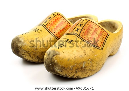 pair of traditional Dutch yellow wooden shoes isolated on white - stock photo