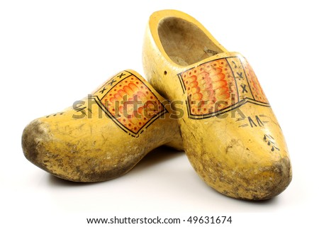 pair of traditional Dutch yellow wooden shoes  on a white background
