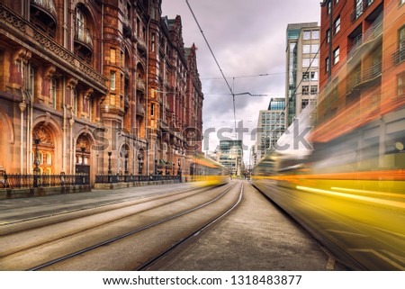 Pair of tram light trails at St Peters Square, Manchester, England.
