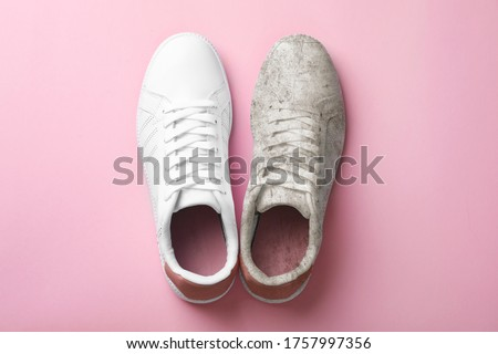 Pair of trendy shoes before and after cleaning on pink background, top view ストックフォト ©
