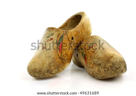 pair of very old traditional Dutch decorated wooden shoes  on a white background