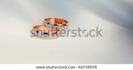 Pair of wedding rings. Very shallow depth of field.